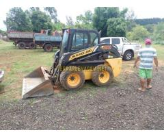 Mini carregadeira New Holland 218